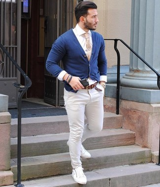 How to wear: white leather low top sneakers, white chinos, white dress shirt, navy cardigan