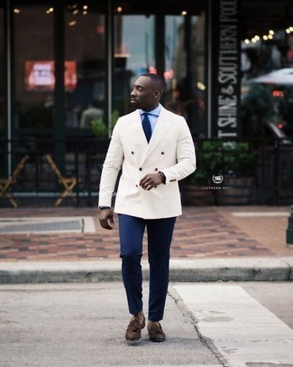How to Wear a White Double Breasted Blazer For Men: Flaunt your classy self in a white double breasted blazer and navy chinos. Go ahead and complement this ensemble with a pair of dark brown suede tassel loafers for an added touch of polish.