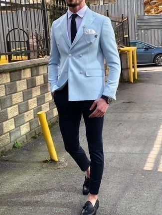 How to Wear a White Pocket Square: A light blue double breasted blazer and a white pocket square are a nice combination to have in your day-to-day off-duty routine. A pair of black leather tassel loafers instantly bumps up the style factor of your ensemble.