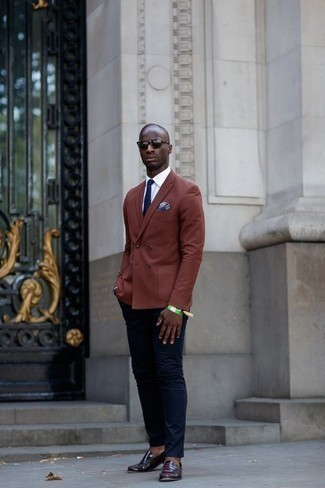 How to Wear a Navy Tie For Men: We love the way this combination of a brown double breasted blazer and a navy tie instantly makes men look refined and dapper. Here's how to dress down this ensemble: dark purple leather loafers.