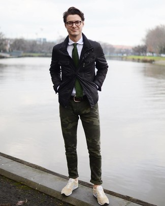 How to Wear Beige Low Top Sneakers For Men: A black field jacket and dark green camouflage chinos are a savvy pairing worth integrating into your casual routine. A pair of beige low top sneakers acts as the glue that ties your look together.