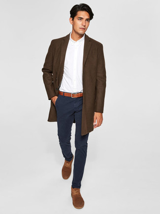 How to Wear a Dark Brown Overcoat: If the setting calls for an effortlessly neat menswear style, you can rely on a dark brown overcoat and black chinos. Go off the beaten track and change up your look by finishing with a pair of brown suede desert boots.