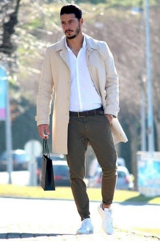 How to wear: white leather low top sneakers, olive chinos, white dress shirt, beige overcoat