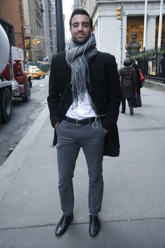 How to wear: black leather derby shoes, charcoal chinos, white dress shirt, black overcoat
