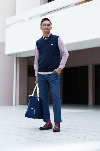 How to Wear Red Socks For Men: To assemble an off-duty outfit with a modern take, you can wear a navy sweater vest and red socks. Complement your outfit with a pair of burgundy leather oxford shoes to make the getup slightly sleeker.