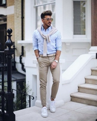 How to wear: white leather low top sneakers, beige chinos, light blue dress shirt, beige v-neck sweater