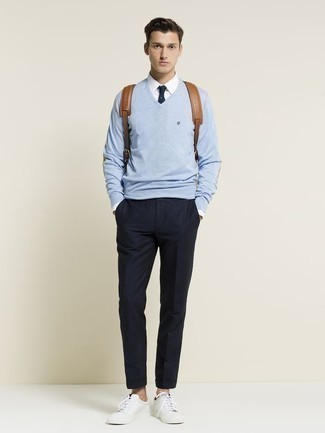 Men's Looks & Outfits: What To Wear In 2020: Such essentials as a light blue v-neck sweater and navy chinos are the perfect way to introduce some cool into your casual wardrobe. If you wish to easily tone down your ensemble with shoes, add a pair of white leather low top sneakers to the equation.