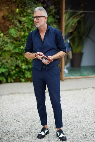 How to wear: black and white leather brogues, navy chinos, navy dress shirt, navy waistcoat