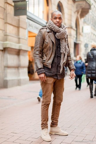 How to wear: beige suede desert boots, brown chinos, charcoal duffle cardigan, brown leather biker jacket