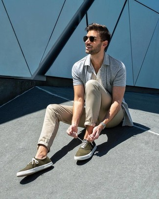 How to wear: olive canvas low top sneakers, beige chinos, white henley shirt, grey short sleeve shirt