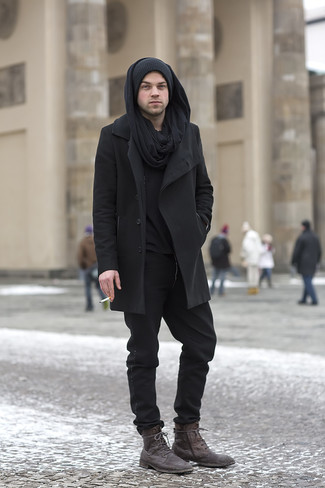 How to wear: dark brown leather casual boots, black chinos, black henley sweater, black overcoat