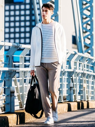 How to wear: white leather low top sneakers, brown chinos, white hoodie, white and blue horizontal striped crew-neck sweater