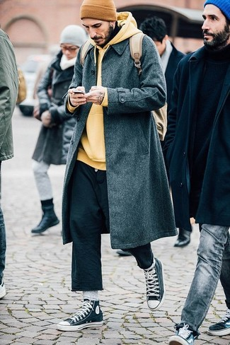 How to wear: charcoal high top sneakers, black chinos, yellow hoodie, charcoal overcoat