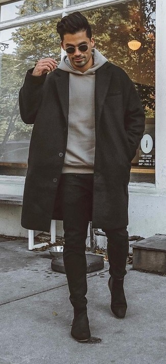 Men's Looks & Outfits: What To Wear In Chill Weather: A black overcoat and black chinos combined together are the perfect combo for gentlemen who appreciate elegant ensembles. On the fence about how to round off this getup? Wear a pair of black suede chelsea boots to class it up.