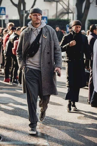 How to Wear Charcoal Wool Chinos: Inject personality into your current routine with a grey overcoat and charcoal wool chinos. You can get a bit experimental in the footwear department and dress down this getup with black leopard low top sneakers.