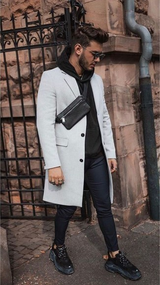 How to Wear Black Athletic Shoes For Men: This pairing of a grey overcoat and navy chinos makes for the perfect base for a myriad of combos. You could perhaps get a bit experimental with shoes and complement this outfit with a pair of black athletic shoes.