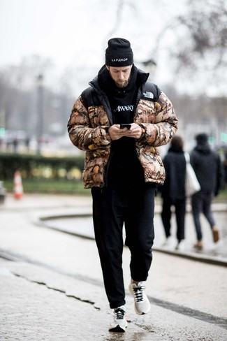 How to Wear White Athletic Shoes For Men: A brown camouflage puffer jacket and black chinos are the kind of a fail-safe getup that you need when you have zero time to craft an outfit. Complete this outfit with white athletic shoes to keep the look fresh.
