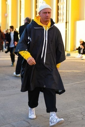 How to Wear a White Beanie For Men: Try teaming a black raincoat with a white beanie if you wish to look neat and relaxed without making too much effort. If you want to instantly up the ante of your look with one single piece, complement your look with white and navy leather high top sneakers.