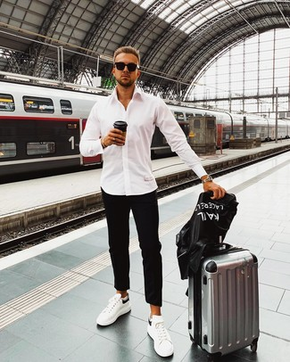 How to Wear White and Black Leather Low Top Sneakers For Men: Consider pairing a black print leather biker jacket with black chinos to achieve new levels in your personal style. White and black leather low top sneakers look amazing here.