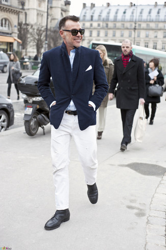 How to wear: black leather desert boots, white chinos, light blue long sleeve shirt, navy blazer