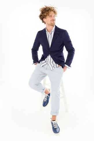 How to wear: navy leather low top sneakers, light blue seersucker chinos, white and blue vertical striped chambray long sleeve shirt, navy blazer