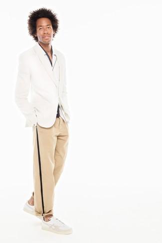 How to wear: white leather low top sneakers, khaki chinos, white long sleeve shirt, white blazer