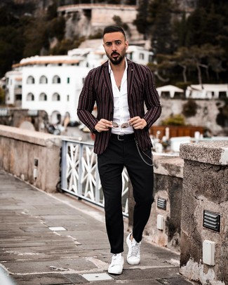 How to wear: white leather low top sneakers, black chinos, white long sleeve shirt, black vertical striped blazer
