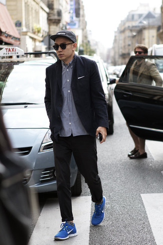 How to Wear a Black Blazer For Men: For a look that's worthy of a modern fashionable guy and effortlessly neat, pair a black blazer with black chinos. A pair of blue athletic shoes will easily tone down an all-too-perfect ensemble.