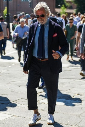 Fashion for Men Over 60: What To Wear: A navy blazer and navy chinos married together are a perfect match. You can take a more laid-back approach with shoes and introduce white and navy leather low top sneakers to the equation.