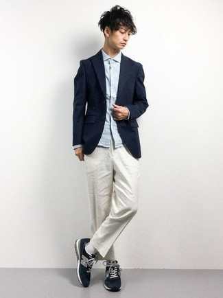 How to Wear a Navy Blazer For Men: This combo of a navy blazer and white chinos is really a statement-maker. If you don't want to go all out formal, enter a pair of navy athletic shoes into the equation.