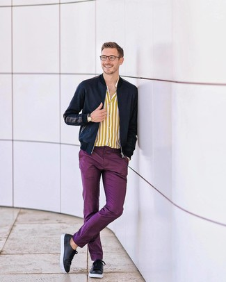 How to wear: black leather low top sneakers, purple chinos, yellow vertical striped long sleeve shirt, navy bomber jacket