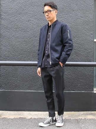 How to Wear a Jacket For Men: Rock a jacket with black chinos for comfort dressing with a modernized spin. Go off the beaten track and jazz up your outfit by sporting a pair of black and white canvas high top sneakers.