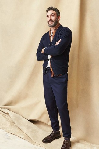 How to wear: dark brown leather brogues, navy chinos, white long sleeve shirt, black cardigan