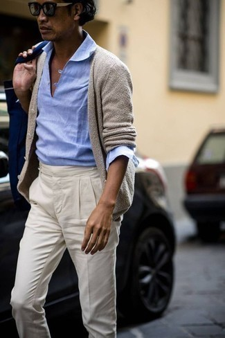 How to Wear a Navy Canvas Tote Bag For Men: The go-to for relaxed casual menswear style? A beige cardigan with a navy canvas tote bag.
