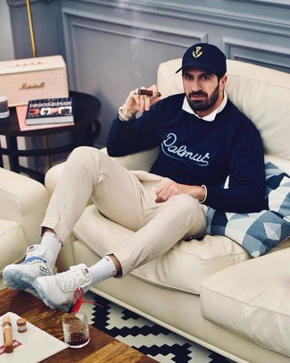 How to wear: white athletic shoes, beige chinos, white long sleeve shirt, navy print crew-neck sweater