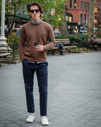 How to Wear a Long Sleeve Shirt For Men: If you're on the lookout for an off-duty yet stylish getup, pair a long sleeve shirt with navy chinos. Why not take a more relaxed approach with footwear and complement your look with a pair of white leather low top sneakers?