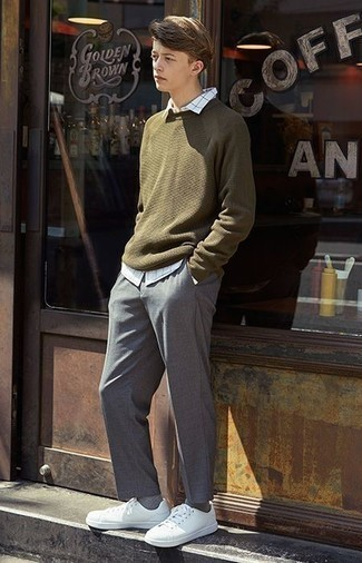 How to Wear an Olive Crew-neck Sweater For Men: An olive crew-neck sweater and grey chinos are the kind of a never-failing off-duty combination that you so awfully need when you have no time. Infuse a fun feel into this outfit by finishing off with a pair of white leather low top sneakers.