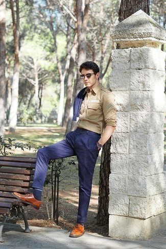How to Wear a Brown Leather Watch For Men: Pair a navy crew-neck sweater with a brown leather watch if you're in search of an outfit idea that speaks laid-back cool. Let your outfit coordination savvy truly shine by finishing off your getup with a pair of tobacco leather brogues.