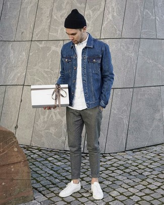 How to Wear a Blue Denim Jacket For Men: This relaxed combination of a blue denim jacket and grey wool chinos is a winning option when you need to look casual and cool but have no time to pick out an outfit. For times when this look looks all-too-classic, tone it down by rocking a pair of white leather low top sneakers.