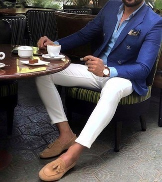 How to Wear Tan Suede Tassel Loafers: For an ensemble that's super straightforward but can be smartened up or dressed down in a ton of different ways, marry a blue double breasted blazer with white chinos. Feel somewhat uninspired with this outfit? Invite tan suede tassel loafers to change things up a bit.