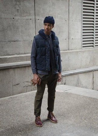 How to wear: dark brown leather work boots, olive chinos, navy print long sleeve shirt, navy gilet