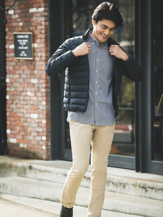 How to wear: black leather loafers, khaki chinos, navy gingham long sleeve shirt, black puffer jacket