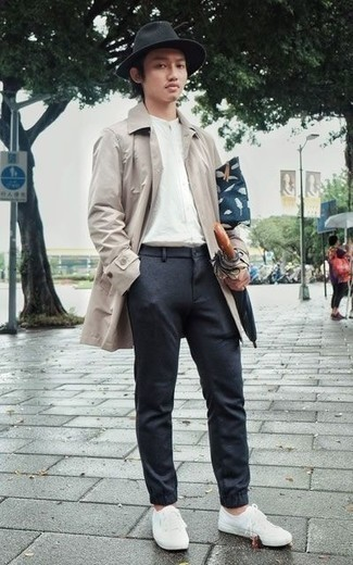 How to Wear a Navy Canvas Zip Pouch For Men: Nail the casually cool getup in a beige raincoat and a navy canvas zip pouch. For something more on the dressier side to round off this look, add white canvas low top sneakers to the equation.