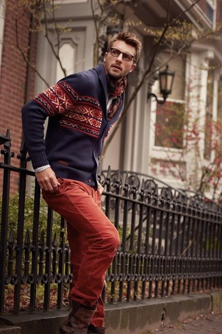 How to wear: dark brown leather chelsea boots, red chinos, beige long sleeve shirt, navy fair isle shawl cardigan