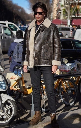 Men's Looks & Outfits: What To Wear In Winter: You'll be surprised at how super easy it is for any guy to throw together this off-duty look. Just a dark brown shearling jacket and black chinos. When it comes to footwear, this look is complemented well with brown leather casual boots. During the colder months, when warmth is a must, it can be easy to settle for a less-than-stylish look in the name of functionality. But this look is a clear example that you can actually stay snug and remain equally stylish in the colder months.