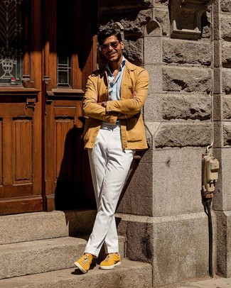 How to wear: yellow suede low top sneakers, white chinos, light blue long sleeve shirt, tan shirt jacket