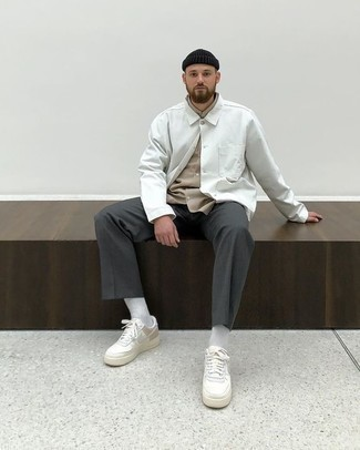 Men's Looks & Outfits: What To Wear In 2020: A white shirt jacket and charcoal chinos matched together are the ideal outfit for those dressers who appreciate elegant looks. White leather low top sneakers will add more character to an otherwise sober ensemble.