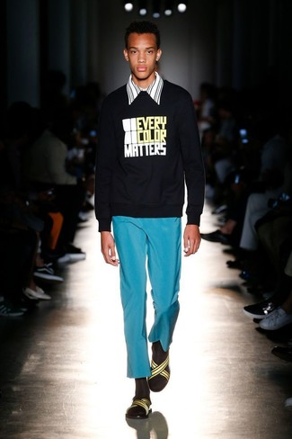 How to wear: yellow canvas sandals, aquamarine chinos, white and black vertical striped long sleeve shirt, black print sweatshirt