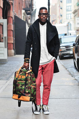 How to wear: black and white canvas low top sneakers, red chinos, white long sleeve shirt, black trenchcoat