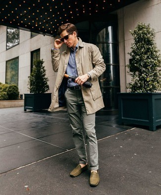 How to Wear a Silver Watch For Men: A beige trenchcoat and a silver watch are among the crucial elements in any modern gentleman's great off-duty sartorial arsenal. Take a classic approach with shoes and add a pair of olive leather driving shoes to the mix.
